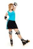 Joli femme sur des patins de rouleau Photographie stock libre de droits