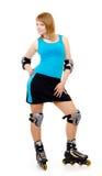 Joli femme sur des patins de rouleau Images stock