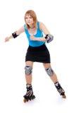 Joli femme sur des patins de rouleau Photos libres de droits