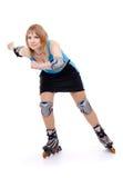 Joli femme sur des patins de rouleau Photos stock