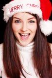 Joli femme utilisant le chapeau de Santa Image stock