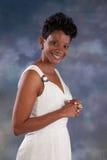 Joli sourire de femme de couleur Photographie stock libre de droits