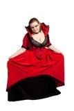 Joli vampire posant dans la robe rouge Photo libre de droits