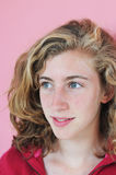 Jolie adolescente dans le rose Image stock