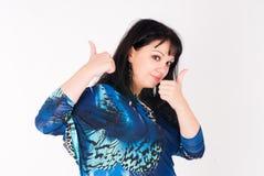 Jolie femme avec des pouces  photographie stock libre de droits