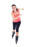 Jolie femme sur des patins de rouleau d'isolement sur le blanc Photo libre de droits