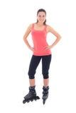 Jolie femme sur des patins de rouleau. tir de studio Photos stock