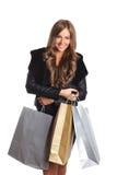 Jolie femme tenant des sacs en papier Photographie stock
