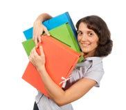 Jolie fille avec beaucoup de dépliants de papier Photographie stock libre de droits