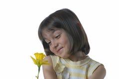 Jolie fille avec la fleur Photographie stock