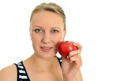 Jolie fille avec la pomme Photo stock