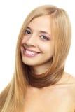 Jolie fille avec le long cheveu sur le blanc Photographie stock libre de droits