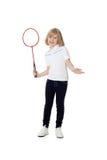 Jolie fille avec une raquette de tennis dans sa main Photos stock