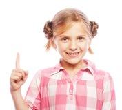 Jolie fille d'école dirigeant son index photo libre de droits