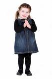 Jolie fille d'enfant en bas âge avec des mains dans la prière Image stock