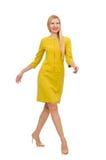 Jolie fille dans la robe jaune d'isolement sur le blanc Image stock