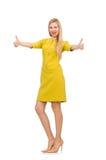 Jolie fille dans la robe jaune d'isolement sur le blanc Photos libres de droits