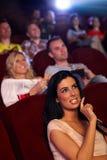 Jolie fille dans la salle de cinéma multiplex Images stock