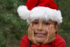 Jolie fille dans le chapeau de Santa Images stock
