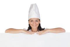 Jolie fille de cuisinier avec l'uniforme Image libre de droits