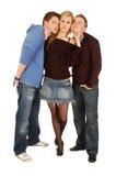Jolie fille et deux beaux types Photographie stock libre de droits