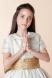 Jolie fille le jour de leur communion Photographie stock libre de droits