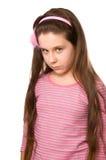 Jolie fille sérieuse à l'âge onze sur le blanc Photographie stock libre de droits