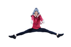 Jolie fille sautant avec montrer des pouces  Photo stock