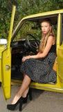 Jolie fille sur le siège conducteur Images libres de droits
