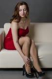 Jolie fille sur le sofa Image stock