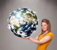 Jolie fille tenant la terre de la planète 3d Image libre de droits