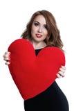 Jolie fille tenant un coeur dans des ses mains Maquillage de luxe Photo stock