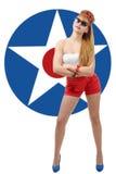 Jolie goupille- de fille avec l'étoile américaine sur le fond Photo stock