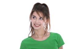 Jolie jeune femme d'isolement regardant en longueur au texte Image libre de droits