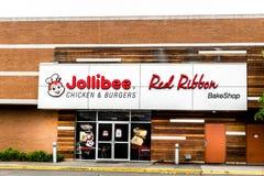 Jollibee餐馆和红色丝带bakeshop店面 免版税库存照片