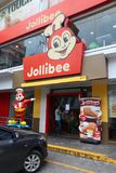 Jollibee fast food. MANILA, PHILIPPINES - DECEMBER 7, 2017: People visit Jollibee fast food restaurant in Manila, Philippines. Jollibee operates 1100 restaurants royalty free stock images