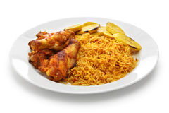 Jollof rice, west african cuisine. Jollof rice with chicken and fried plantain, west african cuisine Stock Photo