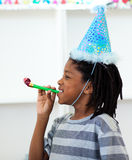 Jolly boy having fun at a birthday party Royalty Free Stock Photos