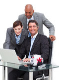 Jolly business team working at a computer Stock Images