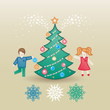 Jolly children with a christmas tree and snowflakes. Stock Photos