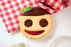 Jolly cookie. Jolly shortbread cookie with jam and chocolate filling Stock Photo