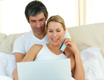 Jolly couple buying on internet Royalty Free Stock Photos