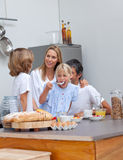 Jolly family having breakfast Royalty Free Stock Photo