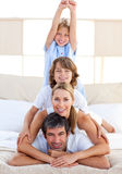 Jolly family having fun. In the bedroom Royalty Free Stock Photos