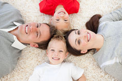 Jolly family lying on the floor Royalty Free Stock Images