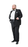 Jolly Fat Man in Tuxedo and Bow tie Shows Emotions Stock Photo
