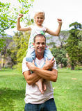 Jolly father giving his daughter piggy-back ride Royalty Free Stock Images