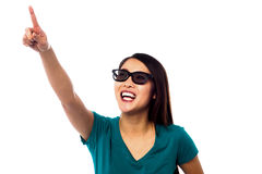 Jolly female model pointing at something Royalty Free Stock Images
