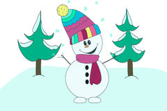 Jolly good fun snowman in colorful scarf and hat on the background of spruce in the snow Royalty Free Stock Photo