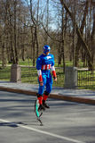 Jolly Jumper. A man dressed as a superhero and jumping with powerizer Royalty Free Stock Image